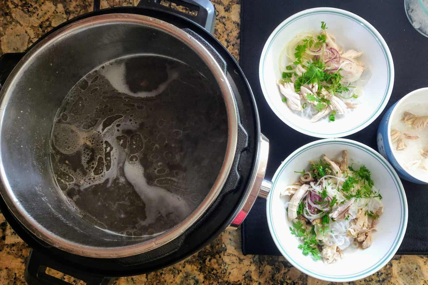 Boiling broth ready to be ladled into pho bowls