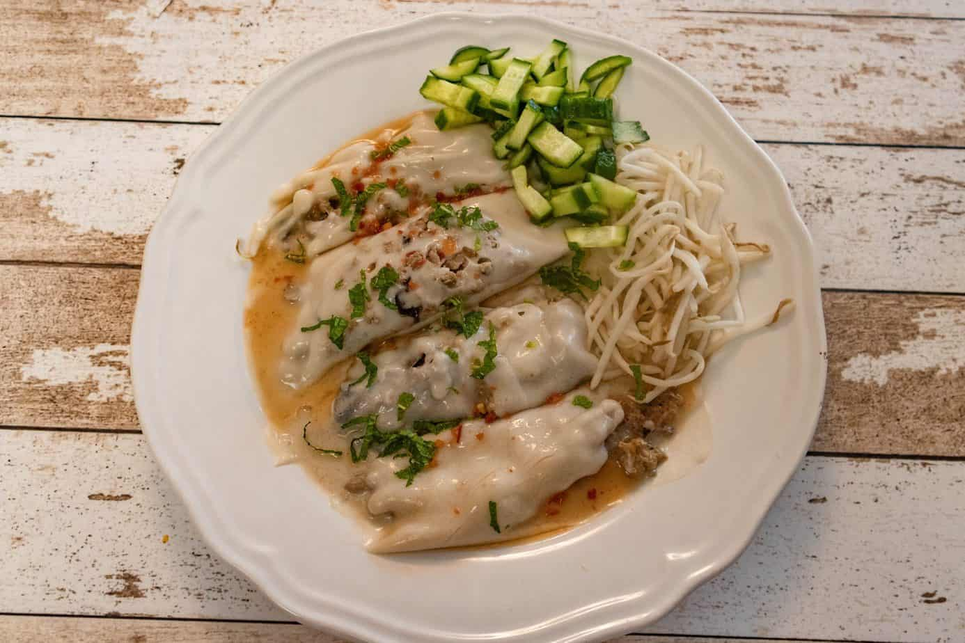 A plate of 4 keto rice rolls with fresh garnishes